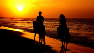 romantic-couple-riding-horses-in-sunset-wallpaper,1366x768,63163
