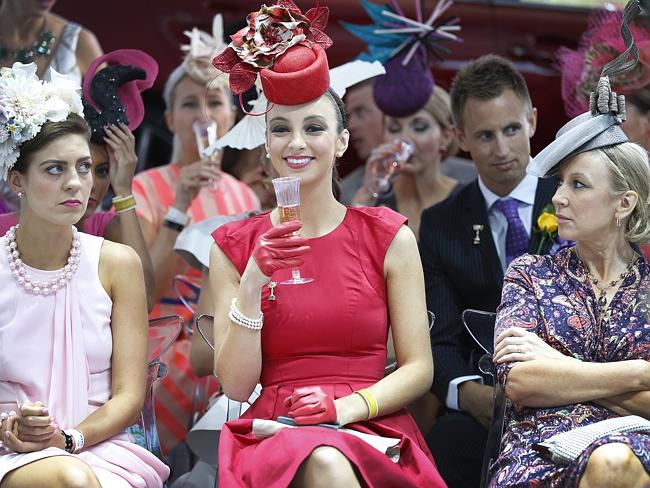 2013 Emirates Melbourne Cup. Myer Fashion in the Field color. Ladies enjoying the judging of Racewear, but some more than others.
